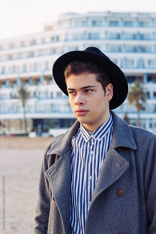 Portrait of young man with jacket and hat by Susana Ramírez for Stocksy United