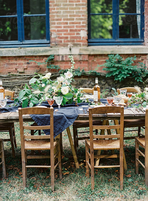 Alfresco family dinner table  by Vicki Grafton Photography for Stocksy United