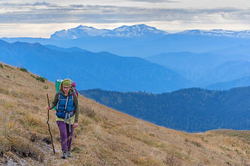 A women walking mountain path  by Sasha Evory for Stocksy United