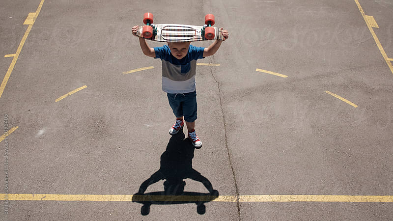 Kid Playing with Skateboard by Branislav Jovanović for Stocksy United