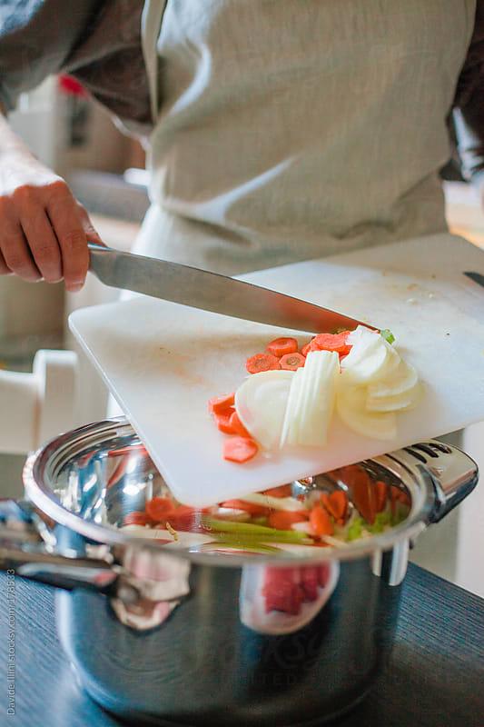 Woman preparing food by Davide Illini for Stocksy United
