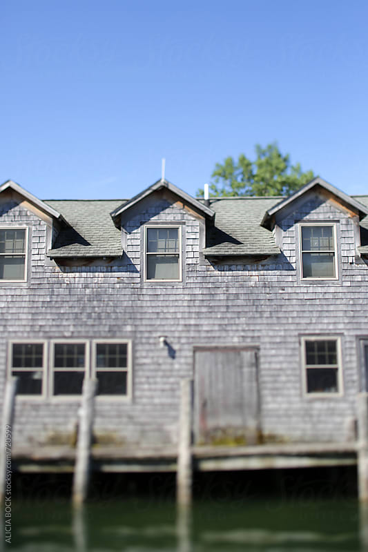 A Rustic Cottage On A Canal Covered With Weathered Wood Siding by ALICIA BOCK for Stocksy United