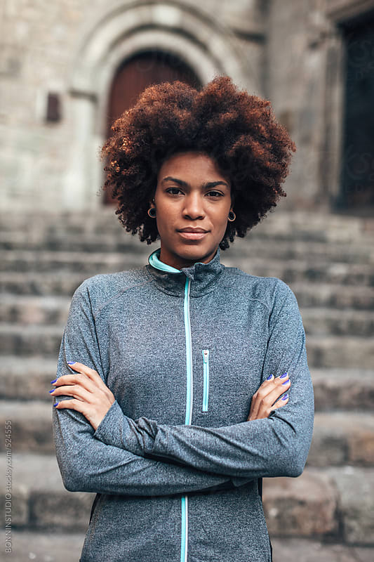 Portrait of a young african american woman wearing sports clothes.  by BONNINSTUDIO for Stocksy United