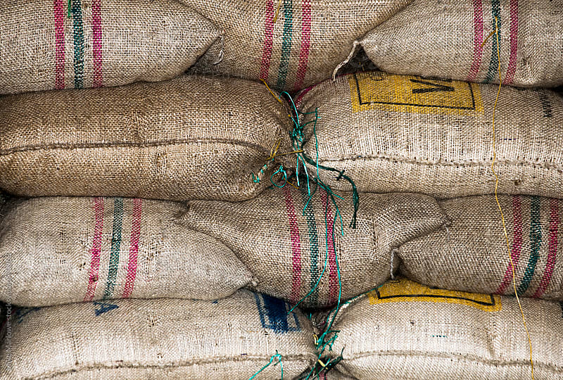 Stack of bags of coffee beans. by Mike Marlowe for Stocksy United