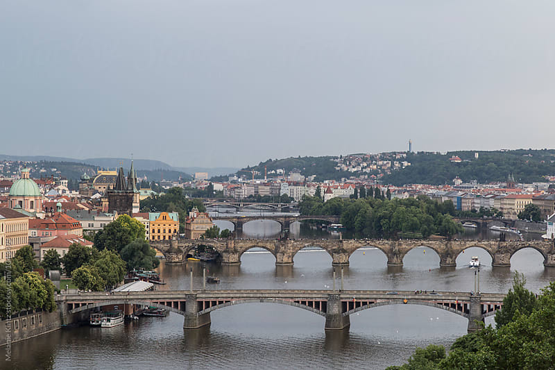 view at the bridges across the Vltava River in Prague by Melanie Kintz for Stocksy United