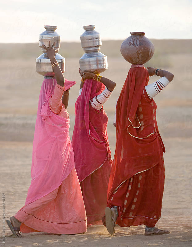 Women carrying water jugs. Rajasthan. India by Hugh Sitton for Stocksy United
