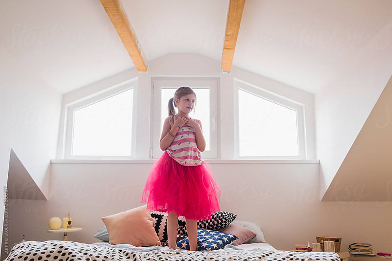 Cute Girl Standing on Bed by Lumina for Stocksy United