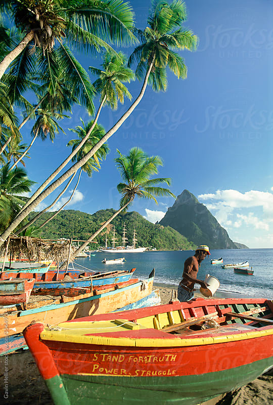 Fishing boats at Soufriere with the Pitons, St. Lucia, Windward Islands, Caribbean by Gavin Hellier for Stocksy United
