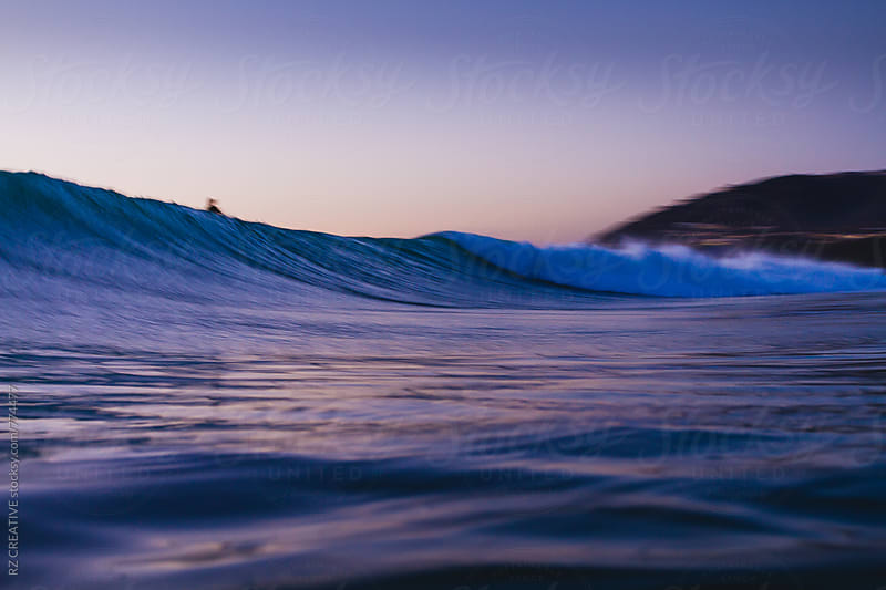 Low angle water shot of a breaking wave at sunset in southern California. by Robert Zaleski for Stocksy United