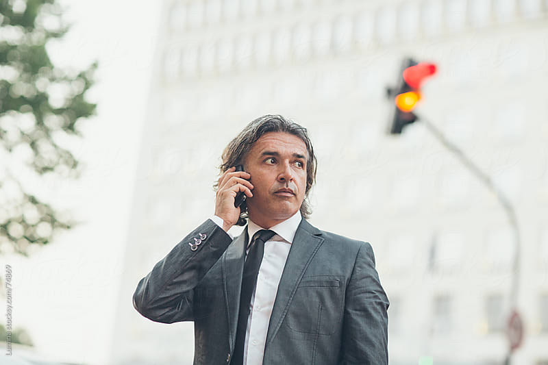 Businessman on the Phone Outdoors by Lumina for Stocksy United
