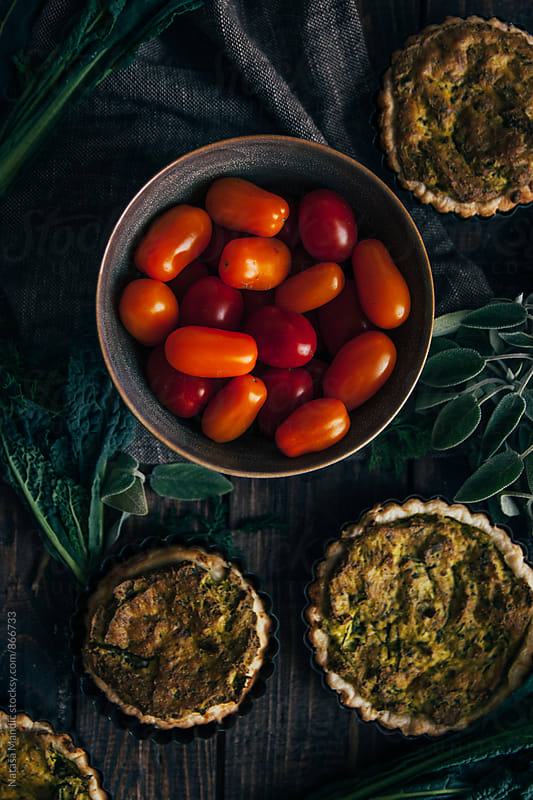 Tomato cherries and delicious vegan quiche by Nataša Mandić for Stocksy United