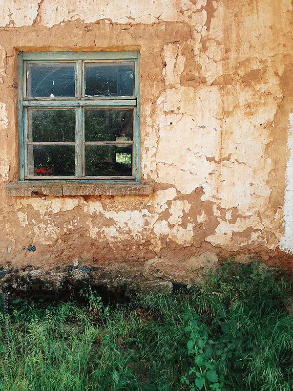 Window on rustic adobe wall  by Borislav Zhuykov for Stocksy United