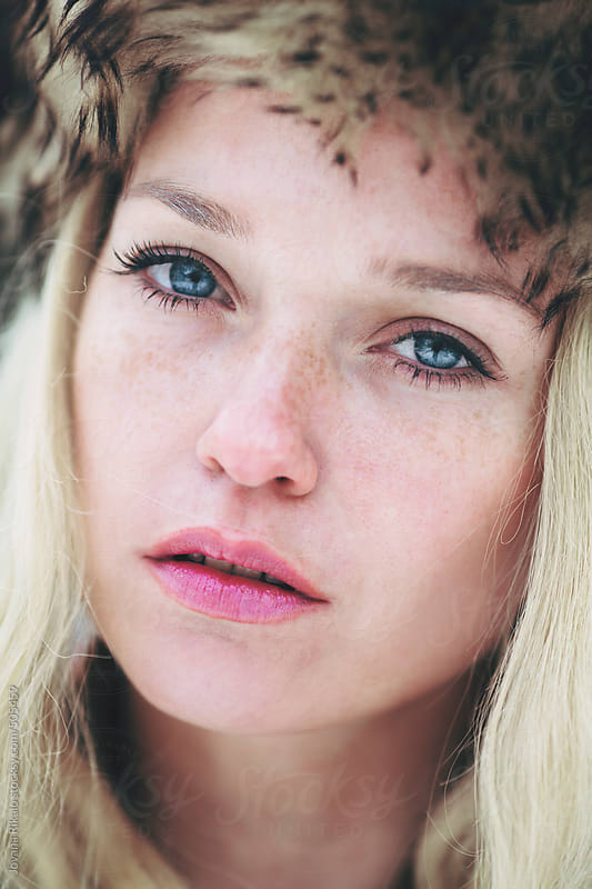 Beautiful freckled woman with blue eyes by Jovana Rikalo for Stocksy United