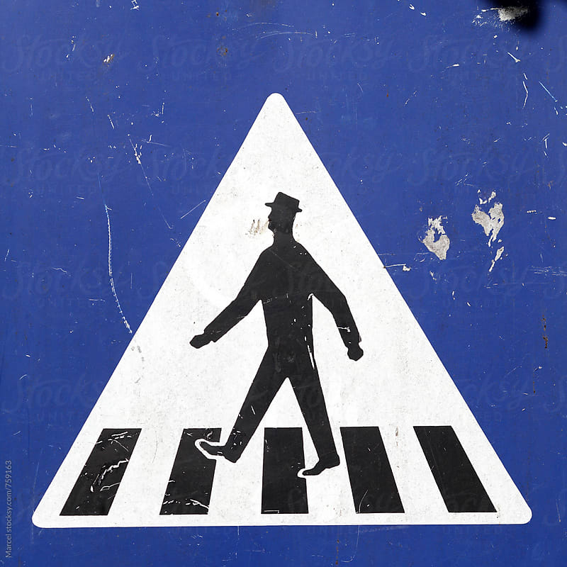 Old traffic sign indicating a zebra crossing by Marcel for Stocksy United