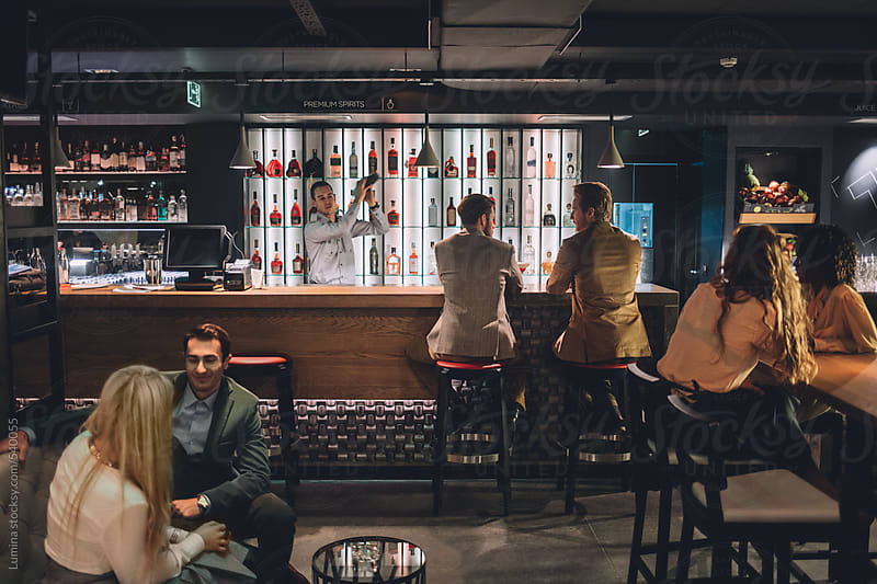 People at a Bar by Lumina for Stocksy United