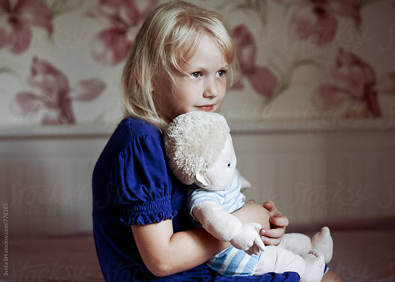 Portrait of a little girl in a blue dress by Svetlana Shchemeleva for Stocksy United