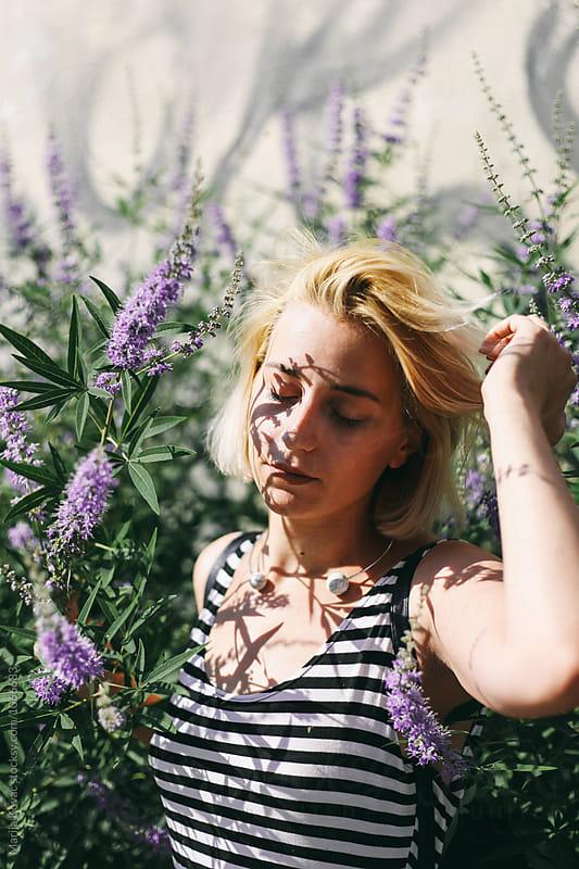 Portrait of a woman outdoor by Marija Kovac for Stocksy United