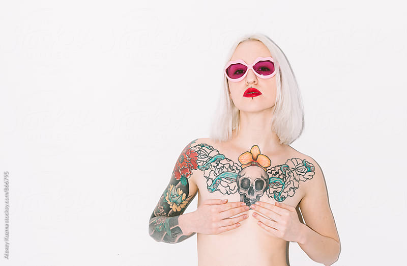 Cool young woman with tattoos by Alexey Kuzma for Stocksy United