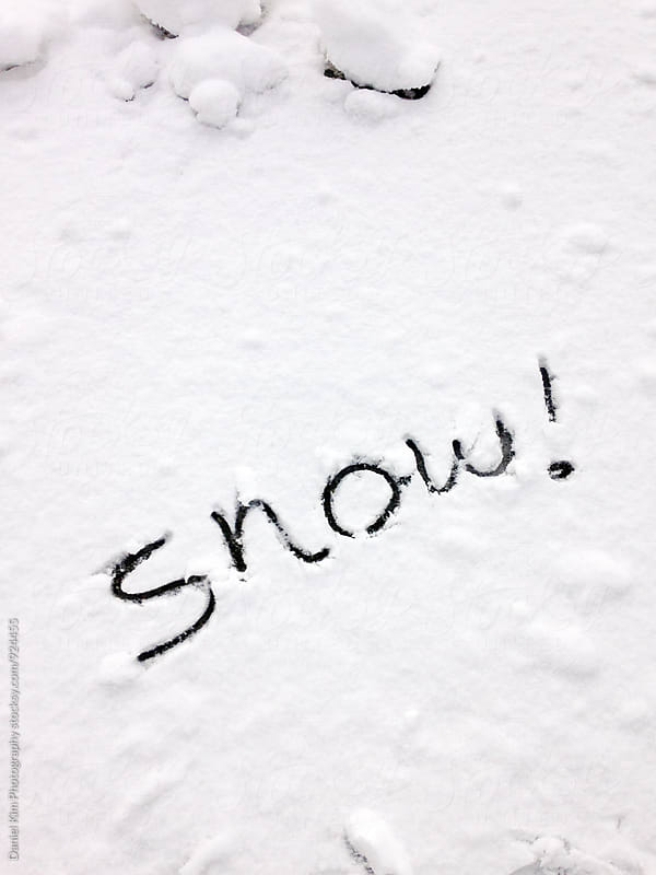 The word snow written in snow by Daniel Kim Photography for Stocksy United