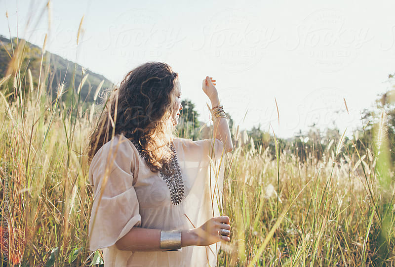 Beautiful Woman Playing in Nature by VISUALSPECTRUM for Stocksy United