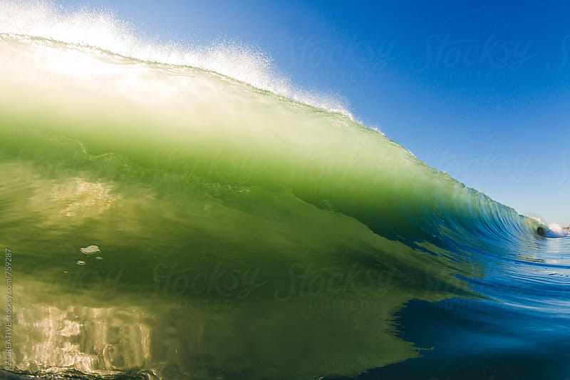 Water shot of a breaking wave on a bright sunny day by RZ CREATIVE for Stocksy United