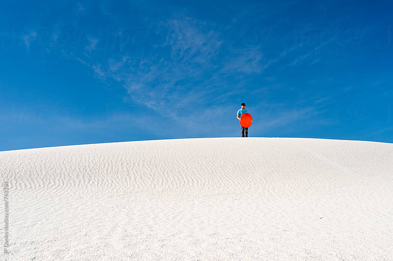 Man Sand Sledding In White Sands National Monument New Mexico by JP Danko for Stocksy United