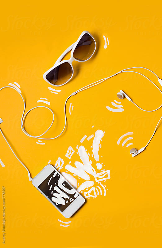 White smartphone and sunglasses with design drawings on yellow background. by Marko Milanovic for Stocksy United