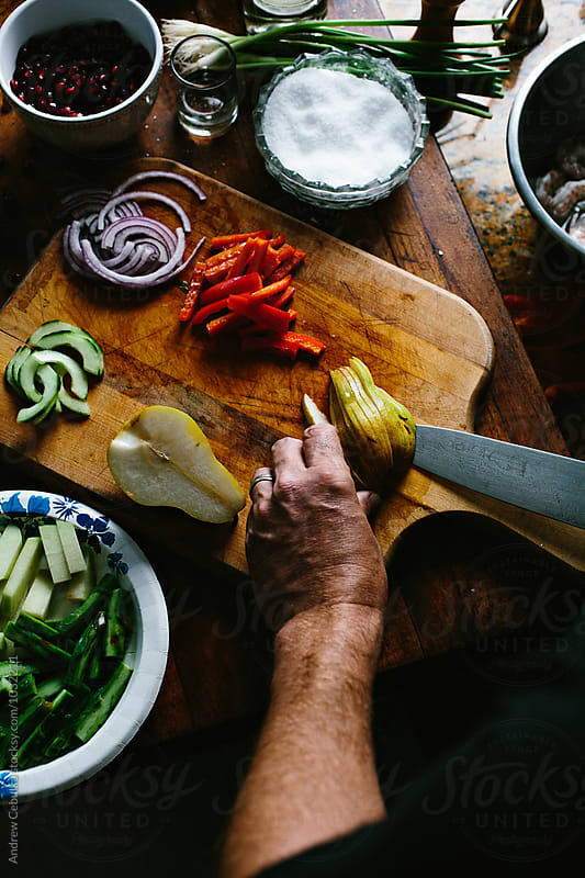 preparing mexican vegetable salad by Andrew Cebulka for Stocksy United