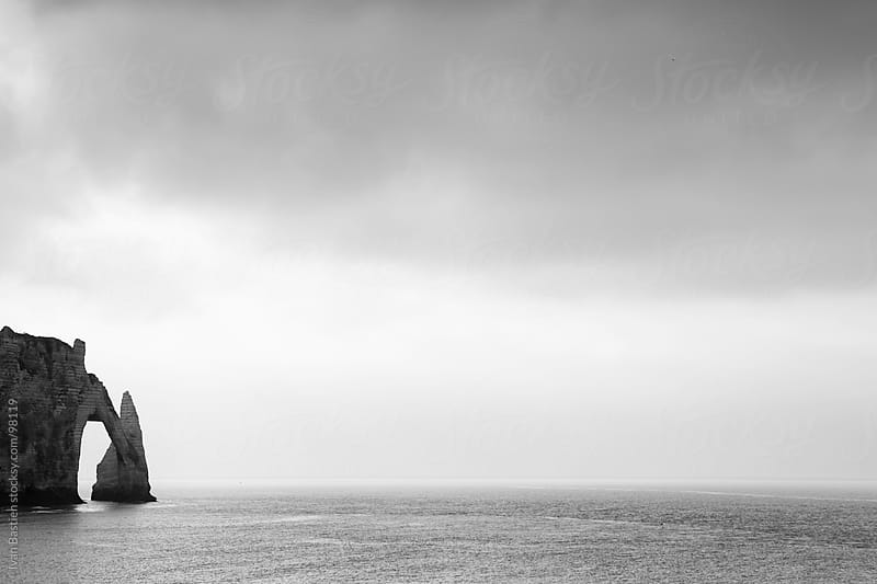 Etretat chalk cliffs in Normandy, France, on a cloudy day by Ivan Bastien for Stocksy United
