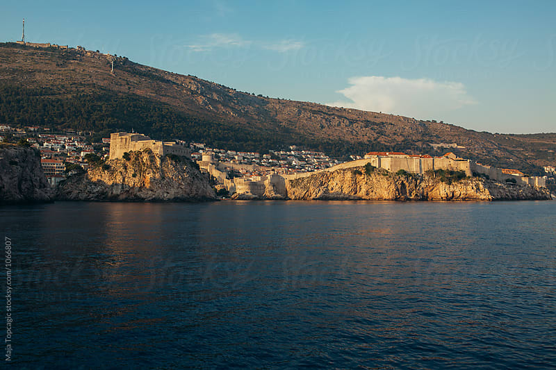 Sailing on a boat through Dubrovnik by Maja Topcagic for Stocksy United