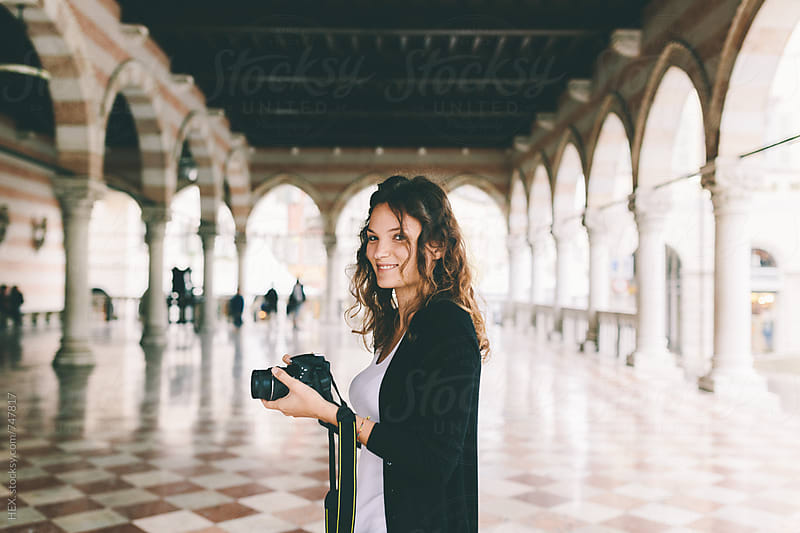 Pretty Young Female Photographer Taking Pictures in Italy by HEX . for Stocksy United