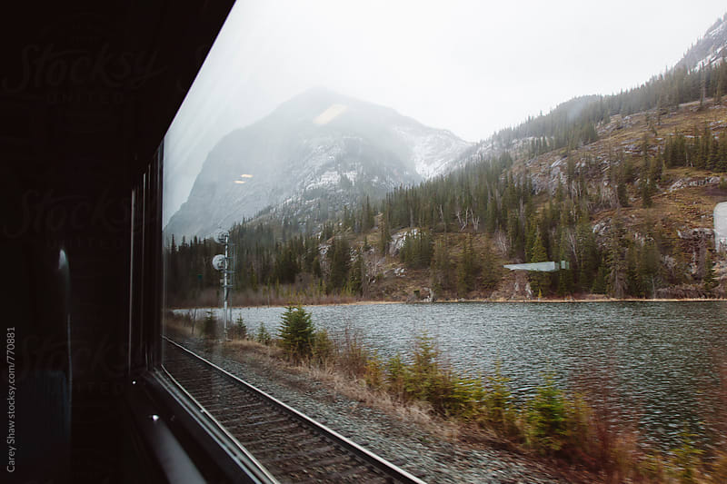 Mountain view from train window by Carey Shaw for Stocksy United