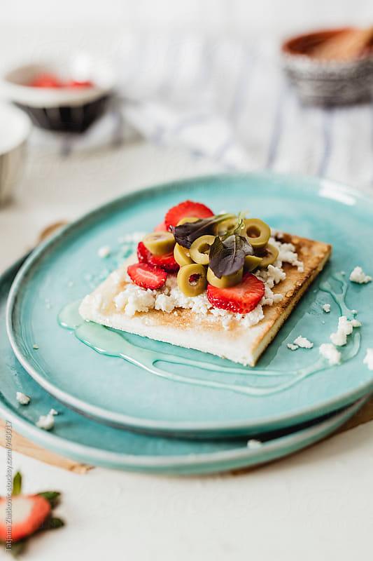 Strawberry sandwich by Tatjana Ristanic for Stocksy United