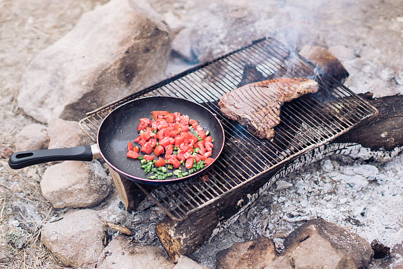 T-bone steak on campground grill by Per Swantesson for Stocksy United