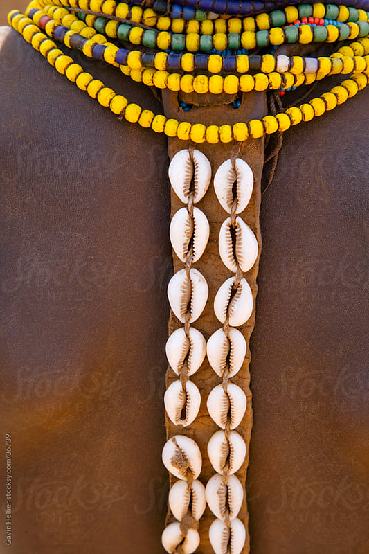 Cowry shells and colourful beads as body decoration (detail), Galeb Tribe, Lower Omo Valley, Ethiopia, Africa by Gavin Hellier for Stocksy United