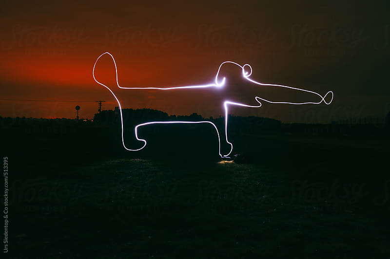 Cartoon sausage dog lightpainting by Urs Siedentop & Co for Stocksy United
