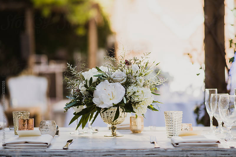 Dinner Party with bright decor by Isaiah & Taylor Photography for Stocksy United