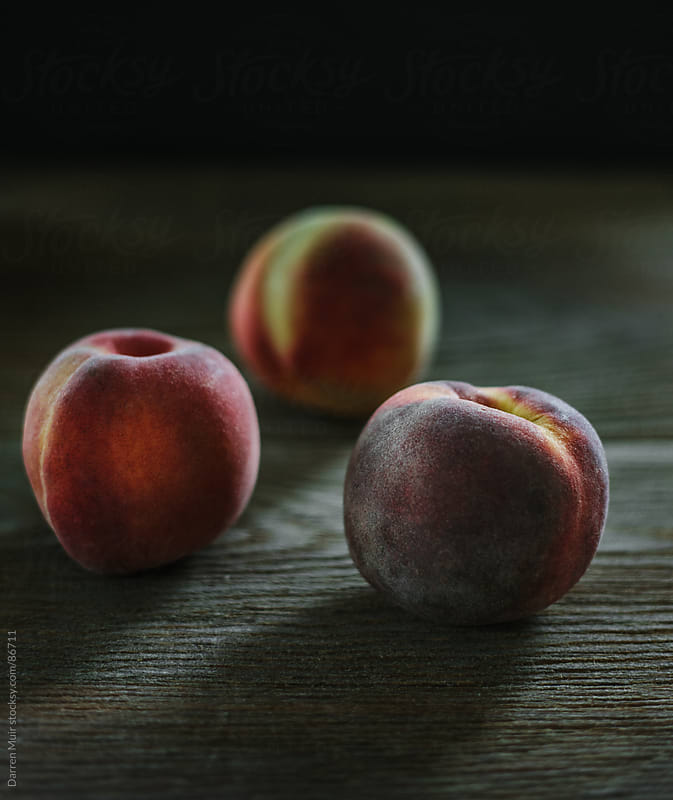 Peaches still life. by Darren Muir for Stocksy United