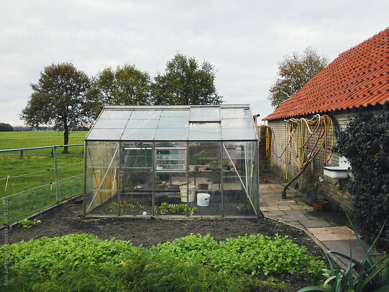 Greenhouse with farm surroundings by Kaat Zoetekouw for Stocksy United