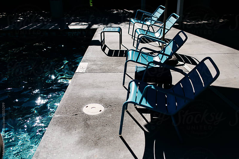 Blue pool chairs by Matt and Tish for Stocksy United