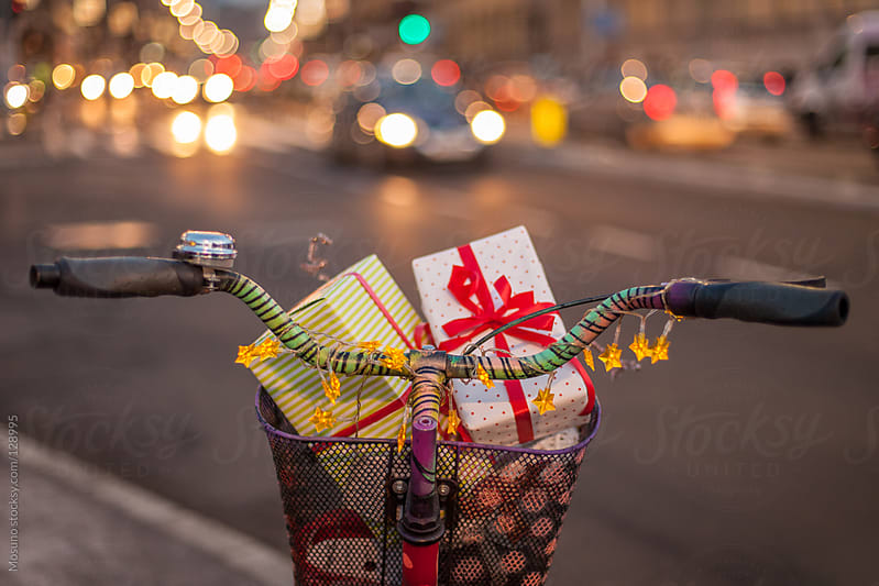 Bicycle with Christmas Gifts in a Basket by Mosuno for Stocksy United