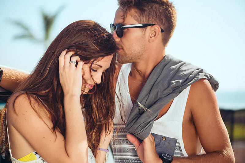 Sexy Couple in summer at the beach front by Aila Images for Stocksy United