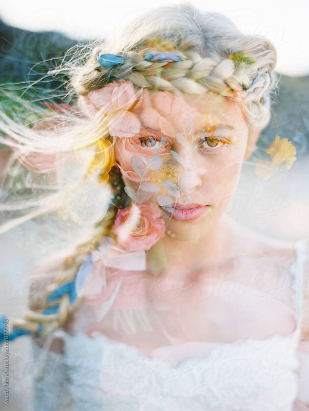 double exposure portrait of blonde bride with braid and flowers by wendy laurel for Stocksy United