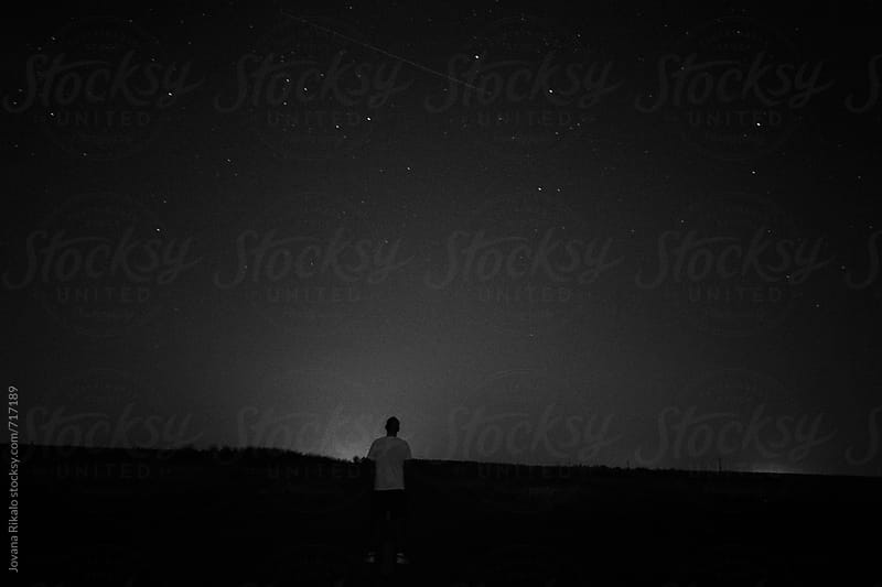Back view of a man watching stars at night by Jovana Rikalo for Stocksy United