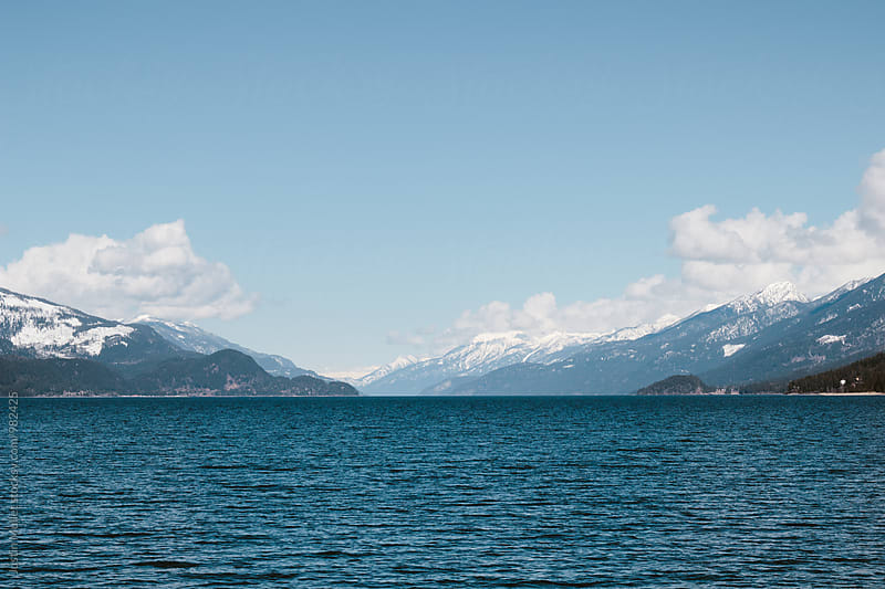 Bright blue water on mountain lake by Justin Mullet for Stocksy United