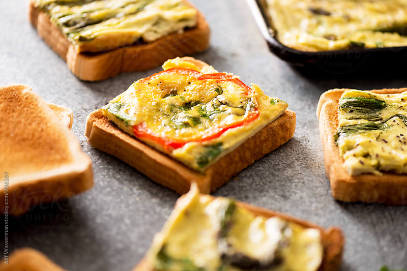 Toast with Sheet Pan Eggs  by Jeff Wasserman for Stocksy United