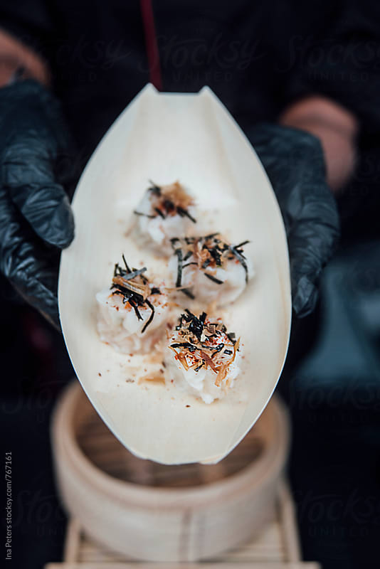 Streetfood: Dim Sum dumplings with prawns, seaweed and chilie by Ina Peters for Stocksy United
