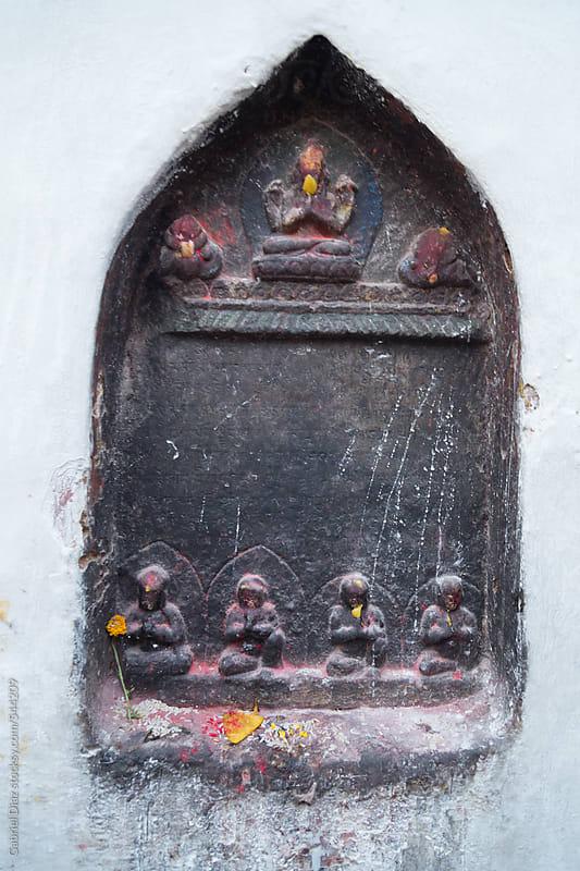 Budhha Deity in ancient temple. Kathmandu by Gabriel Diaz for Stocksy United