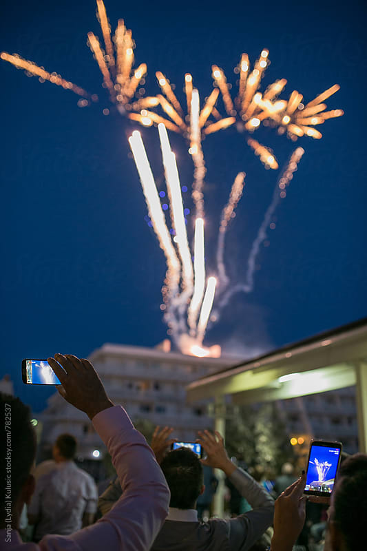 People are photographing fireworks with their phones by Sanja (Lydia) Kulusic for Stocksy United