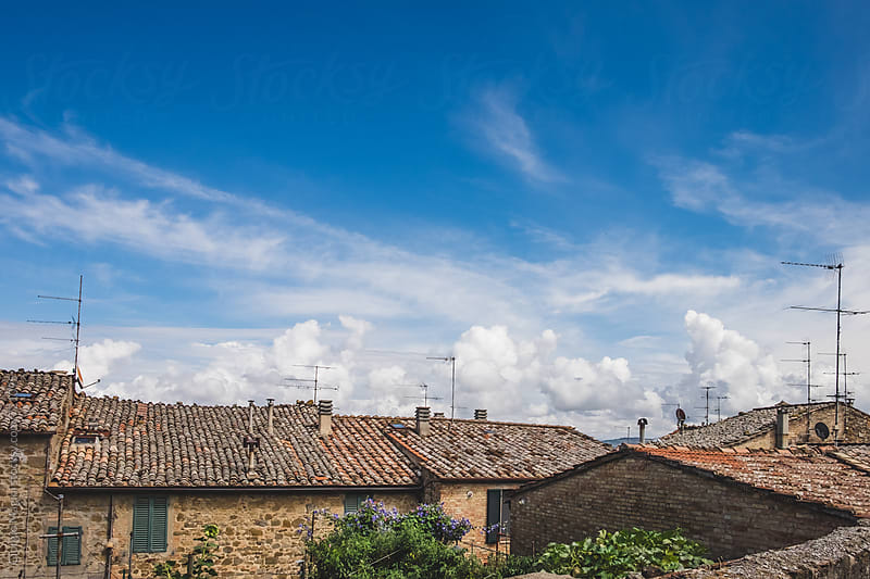 Rooftops under a Cloudy Sky in an Old Tuscan Village, Italy by Giorgio Magini for Stocksy United